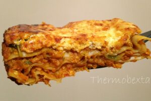 thermomix vegetable lasagne large piece with light coloured background