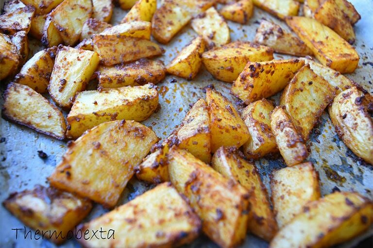 thermomix potato wedges, cooked, on tray