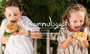 feel good food made easy cover page, two girls excited to eat their bread bowls filled with soup!